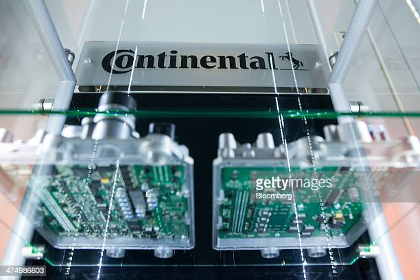 The Continental AG logo sits on a display case containing electronic circuit boards inside the company's automotive powertrain division factory in...