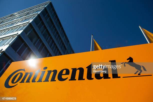 The Continental AG logo stands on display outside the company's automotive powertrain division factory in Regensburg Germany on Tuesday Feb 25 2014...