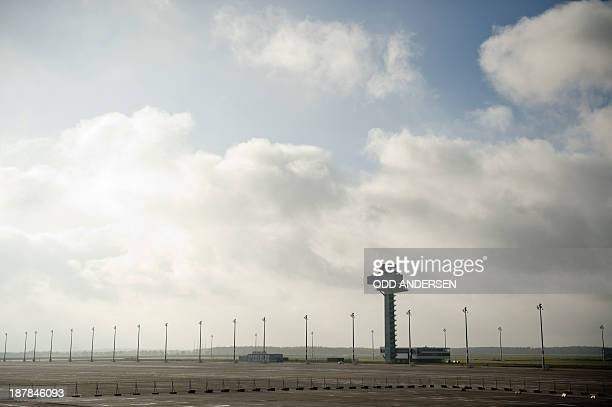 The control tower is seen on the tarmac at the new BerlinBrandenburg Airport in Schoenefeld close to Berlin northeastern Germany on November 13 2013...