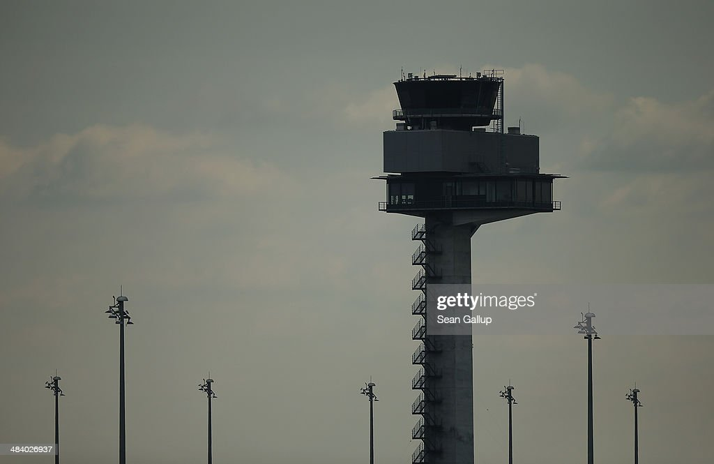 The control tower stands on the construction site of the new Willy Brandt Berlin Brandenburg International Airport on April 11, 2014 in Schoenefeld, Germany. The management board of the new aiport met earlier in the day and confirmed that at least an addiitonal EUR 1.1 billion will be necessary to cover costs of completing the airport. The new airport, which was originally planned to cost EUR 1.7 billion, will now cost at least EUR 5.4 billion and is three years behind schedule with no new date for operation begin announced.