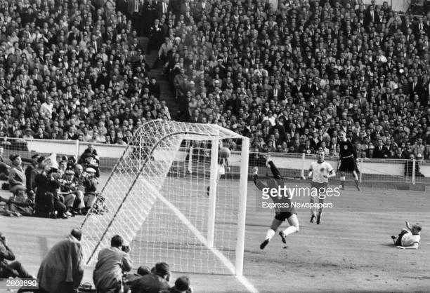 The controversial third goal is scored during the World Cup Final between England and West Germany at Wembley England went on to take the cup by four...