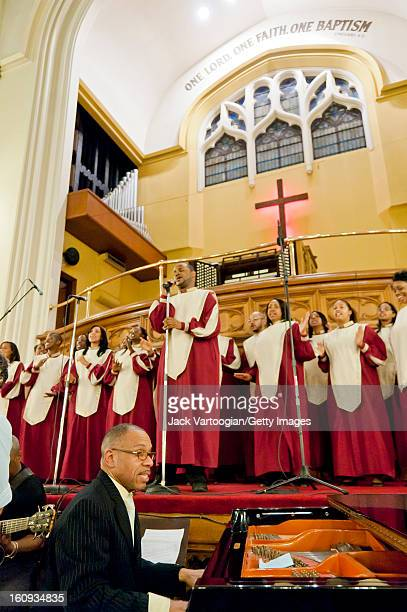 The Convent Avenue Baptist Church Inspirational Ensemble directed by Dr Gregory Hopkins on piano perform during 'A Special Concert in Harlem' at the...