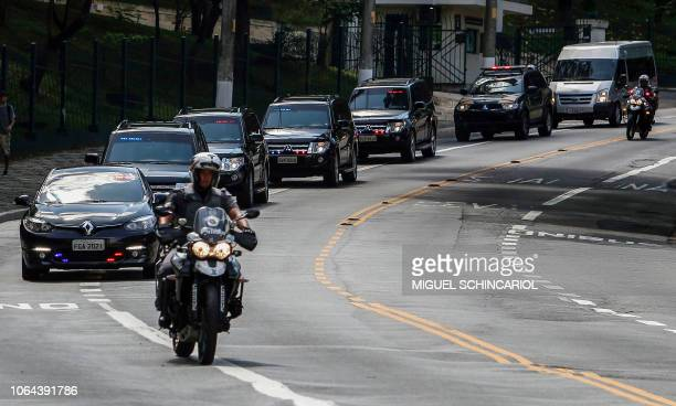 The convoy carrying Brazilian presidentelect Jair Bolsonaro is pictured on its way to the Albert Einstein Hospital in Sao Paulo Brazil on November 23...