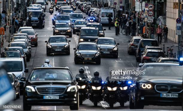 The convoy escorting the Turkish President and his wife is pictured in the streets of the German capital on its way to the presidential Bellevue...