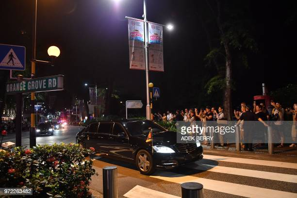 The convoy of North Korean leader Kim Jong Un are pictured on the road as they drive for his departure in Singapore on June 12 2018 Donald Trump and...