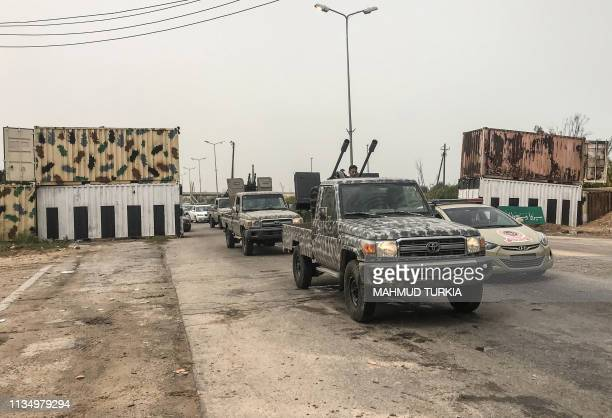 The convoy of the head of Libya's UNbacked unity government Fayez alSarraj is seen moving after meeting with military and security commanders of the...