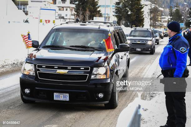The convoy of US President Donald Trump arrives at the congress palace during the annual World Economic Forum on January 26 2018 in Davos eastern...