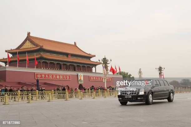 The convoy of US President Donald Trump makes its way through Tiananmen Square before the welcome ceremony on November 9 2017 in Beijing China At the...
