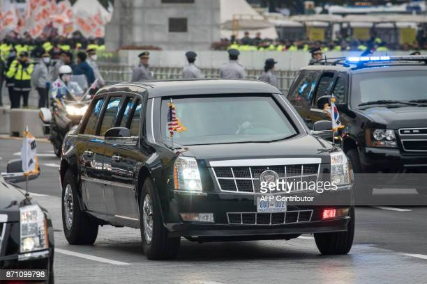 The convoy of US President Donald Trump makes its way towards the presidential Blue House through Gwanghwamun square in central in Seoul on November...