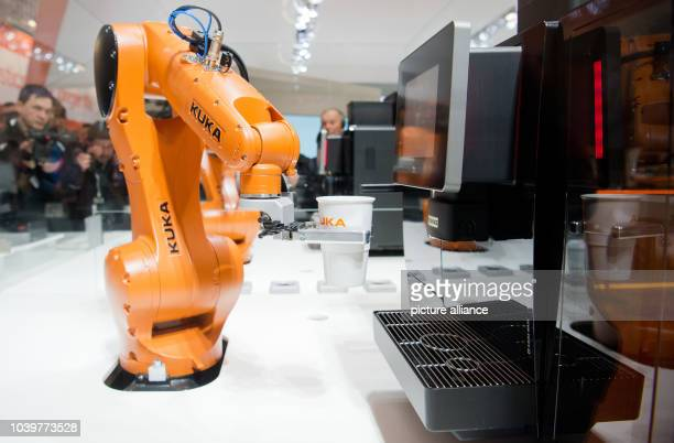 The Cooffe 40 system consisting of an app and a robot makes coffe at the exhibition booth of Kuka at Hanover fair in Hanover Germany 23 April 2016...