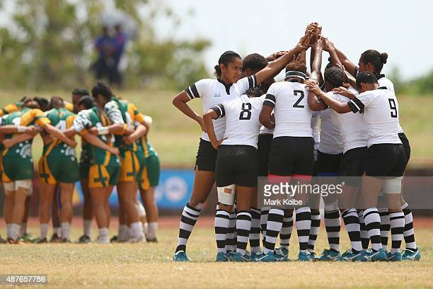 The Cook Island and Fiji prepare for the start of the girls rugby sevens bronze medal match between Fiji and the Cook Islands at the Apia Park Sports...