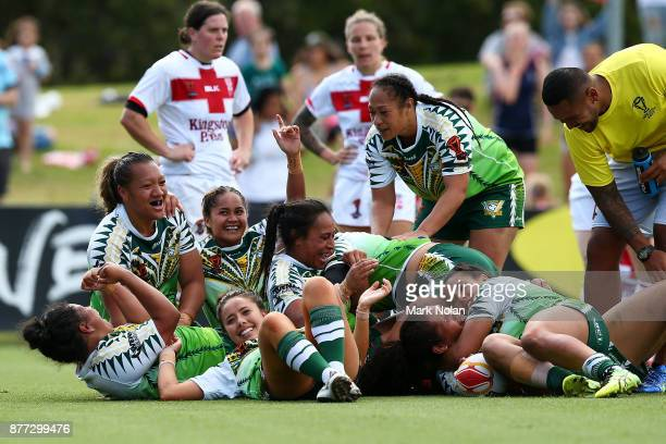 The Cook Island players celebrate a try on full time to win the Women's Rugby League World Cup match between England and the Cook Islands at Southern...