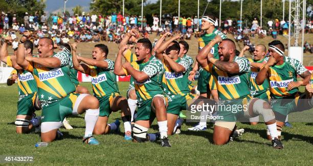 The Cook Islands perform the Pe'e during the Rugby World Cup 2015 qualifying match between Fiji and the Cook Islands at Churchill Park on June 28...