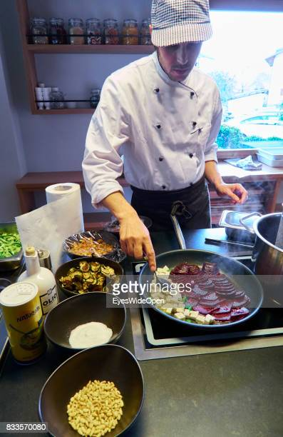 The cook of Hotel Schwarzschmied is preparing vegetarian food with beet roots on April 21 2015 in Lana Italy