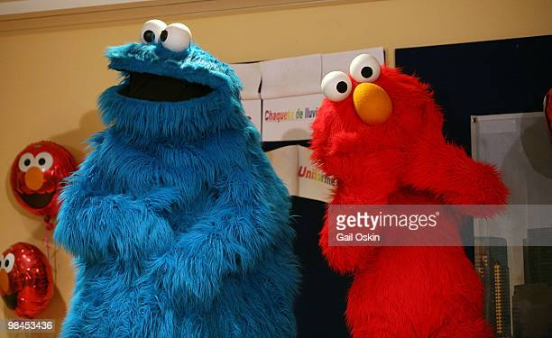 The Cookie Monster and Elmo on the Midweek Morning Show at Children's Hospital Boston on April 14, 2010 in Boston, Massachusetts.