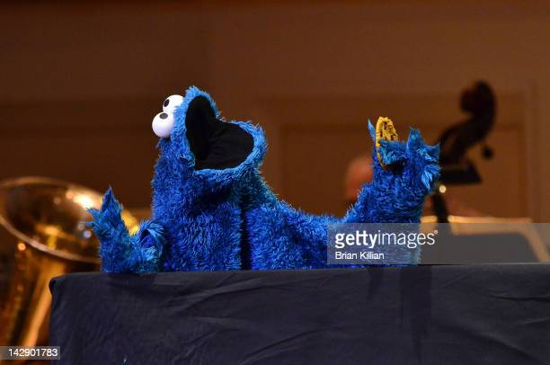 """The Cookie Monster performs during The New York Pops Present """"Jim Henson's Musical World"""" at Carnegie Hall on April 14, 2012 in New York City."""