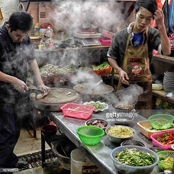 CONTENT] The cooks at a small Chinese restaurant near Shenzhen China Steaming dishes and bowls of raw ingredients ready for the wok