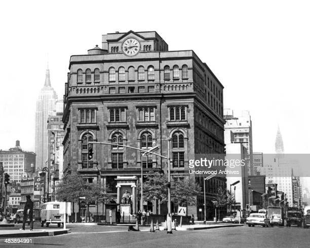 The Cooper Union Building flanked by the Empire State and the Chrysler Buildings in the background New York New York early 1960s