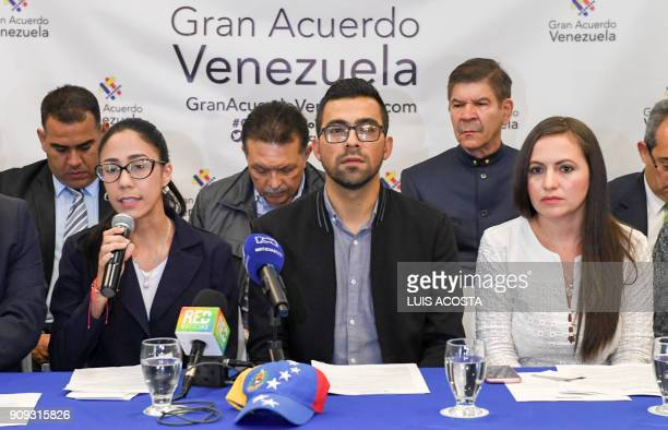 The coordinator of Venezuela's political party Voluntad Popular in Colombia Francine Howard and party members Yulia Torres and Julian Camargo take...