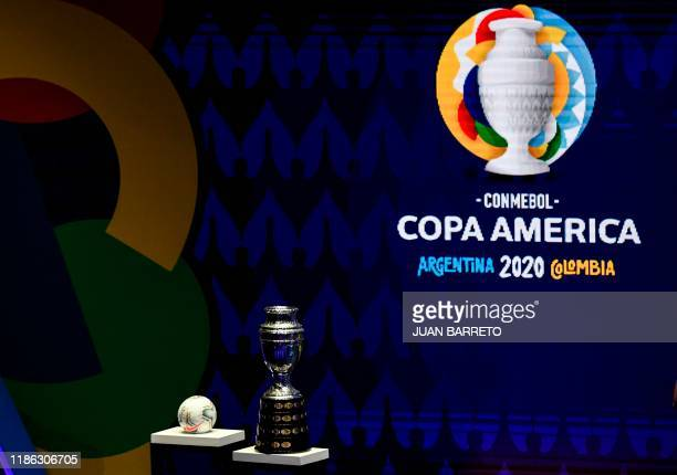 The Copa America trophy and the official ball are seen during the draw of the Copa America 2020 football tournament, at the Convention Centre in...