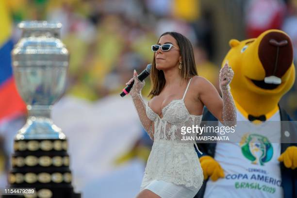 The Copa America trophy is displayed as Brazilian singer Anitta performs near the mascot of the Copa America, Zizito, during the closing ceremony of...