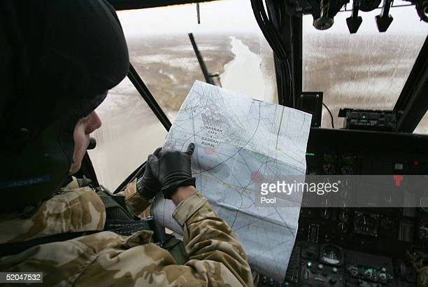 The copilot of a British helicopter looks at a map while flying January 22 2005 in Umm Qasr Iraq Interim Prime Minister Iyad Allawi said Janurary 21...
