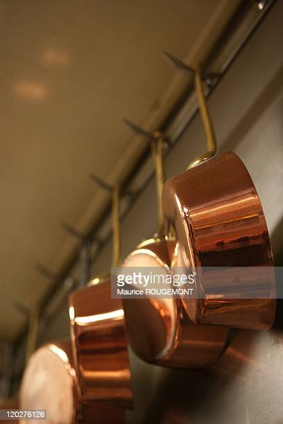 The copper pans in the kitchen of the restaurant 'Paul Bocuse' on February 8 2011 in CollongesauMontd'Or near LyonFrance