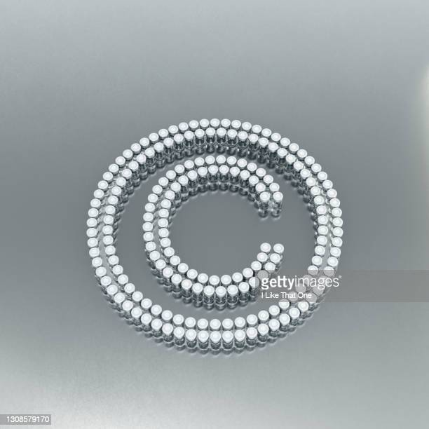 the copyright © symbol made from many medicine bottles arranged, from above - atomic imagery stock pictures, royalty-free photos & images