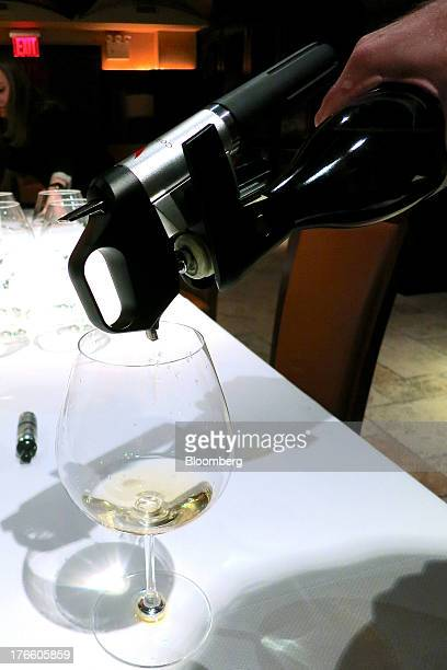 The Coravin a wine preservation device pours out wine from a 2010 Alex Gambal Meursault Clos du Cromin bottle at Del Posto restaurant in New York US...