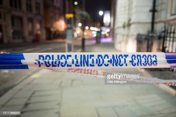 The cordon line of the scene where a man has been shot dead by police in whitehall overnight on March 9, 2020 in London, England. It has been...