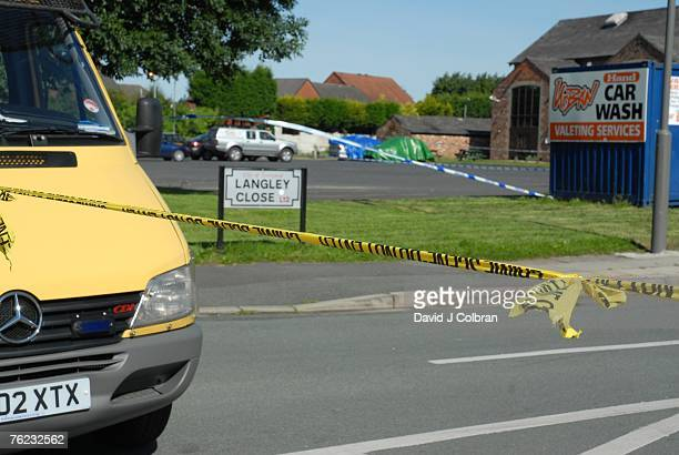 The cordoned off road next to the pub where elevenyearold Rhys Jones was shot by a youth on a BMX bicycle is seen on August 23 2007 in Liverpool...