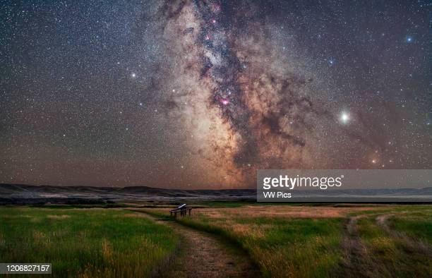 The core of the Milky Way in Sagittarius low in the south over the Frenchman River valley at Grasslands National Park, Saskatchewan. This is from the...