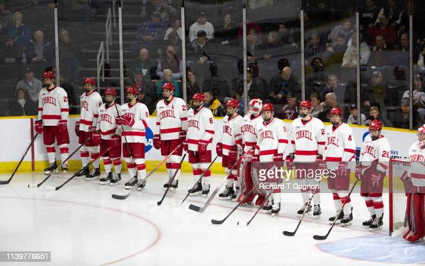 The Cornell Big Red listen to the national anthem before a game against the Providence College Friars during the NCAA Division I Men's Ice Hockey...