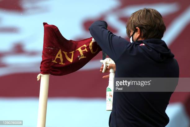 The corner flag is disinfected prior to the Premier League match between Aston Villa and Sheffield United at Villa Park on June 17, 2020 in...