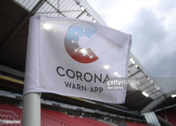 The corner flag is pictured with the corona warn app logo prior to the Bundesliga match between 1 FSV Mainz 05 and SV Werder Bremen at Opel Arena on...