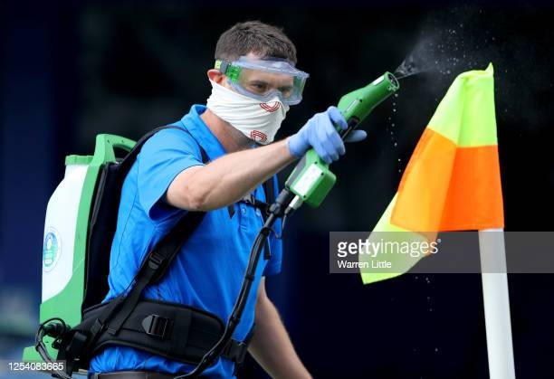 The corner flags are disinfected before the Sky Bet League One Play Off Semifinal 1st Leg match between Portsmouth FC and Oxford United at Fratton...