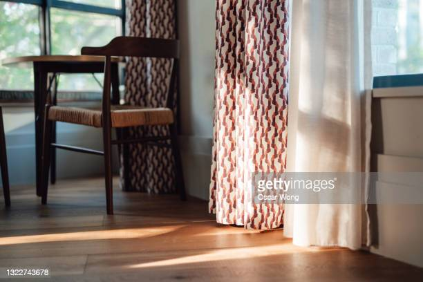 the corner of a stylish domestic room with beautiful sunlight - sheer fabric stock pictures, royalty-free photos & images