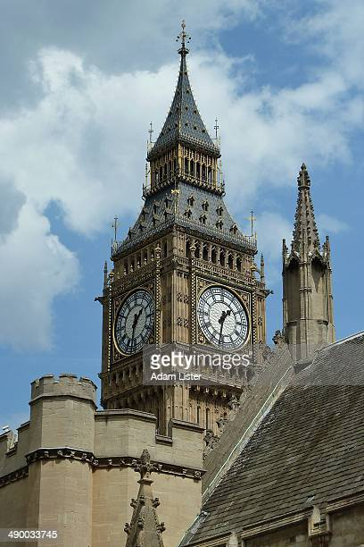 The corner of Parliament with the iconic 'Big Ben' behind against a blue and white cloud sky.