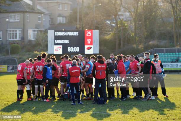 The Cornish Pirates team celebrate following their victory during the Greene King IPA Championship match between Cornish Pirates and Saracens at...