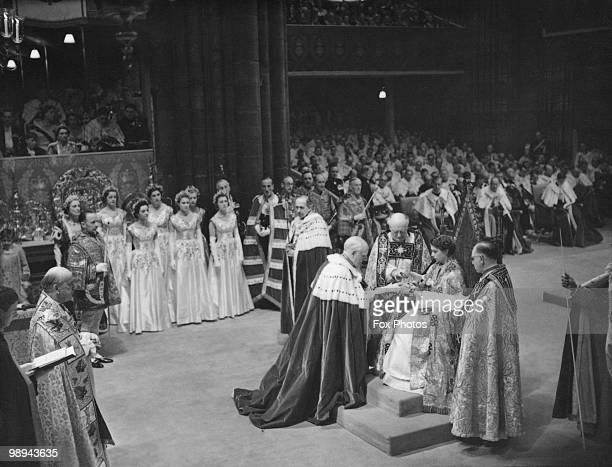 The coronation ceremony of Queen Elizabeth II in Westminster Abbey London 2nd June 1953 The ceremony is presided over by Archbishop of Canterbury...