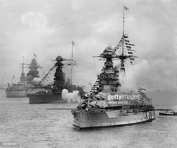 The coronation fleet review of Georg VI at Splithead the battleships HMS Barham HMS Ramillies and 'Dunquerque' firing their cannons Vintage property...