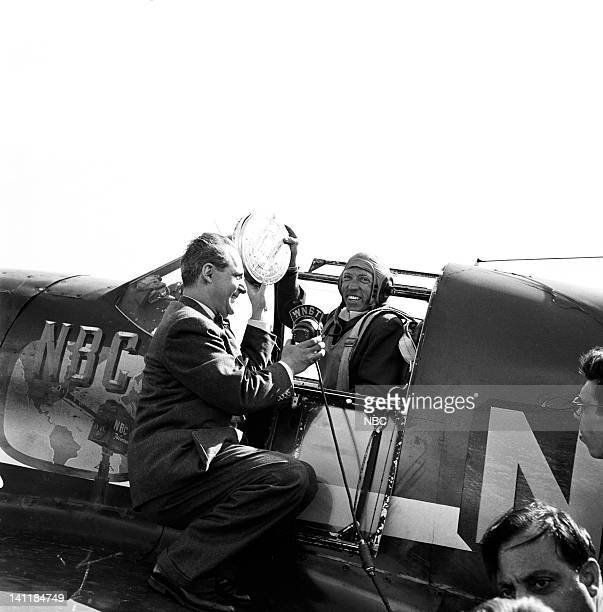 NBC NEWS 'The Coronation of Queen Elizabeth II' Pictured NBC Newsman hands off a newsreel of the coronation of Queen Elizabeth II to a pilot for...