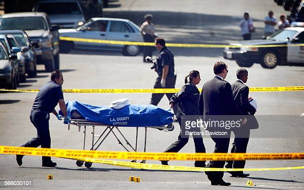 The coroner's office remove the body of an off–duty Los Angeles County sheriffs deputy who works in Mens Central Jail was shot and killed near his...