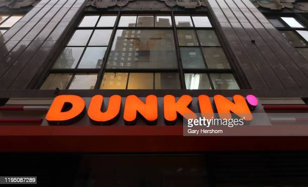 The corporate logo for Dunkin' replacing the former name of Dunkin Donuts sits above the entrance to a store on 38th Street on December 16 in New...