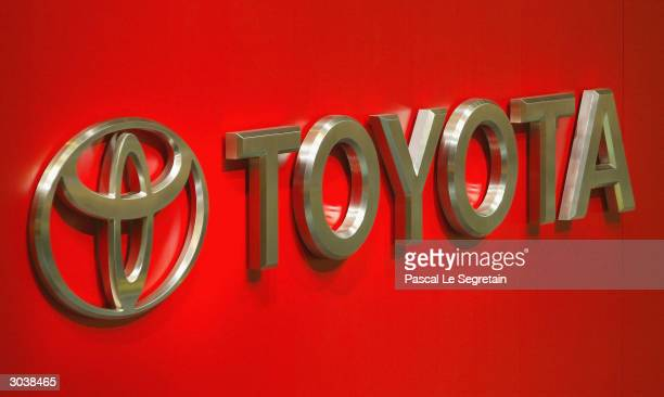 The corporate Logo of the car company Toyota is seen March 3 2004 at the International Motor Show in Geneva Switzerland Motor manufacturers from...