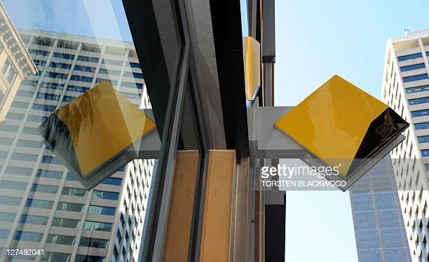 The corporate logo of the Commonwealth Bank adorns a city branch in Sydney on August 10 2011 Australia's biggest bank posted a 13 percent rise in...