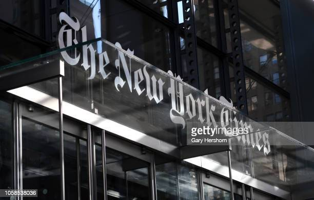 The corporate logo of the New York Times hangs above the front door of their headquarters on October 23 2018 in New York City