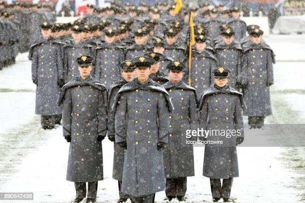 The Corps of the Cadets stand on the field as snow falls on December 9 2017 at Lincoln Financial Field in Philadelphia Pa for the 118th Army Navy...