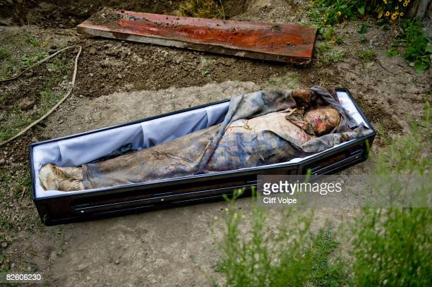 The corpse of 59 year old Aleko Bibilashvili lies in a coffin in his front yard on August 25 2008 in Karaleti Georgia Bibilashvili was shot dead from...