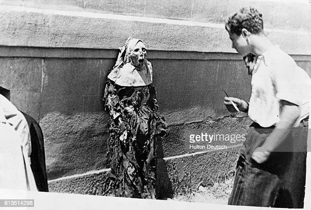 The corpse of a Carmelite nun on public display in Barcelona Spain during the Spanish Civil War July 1936 | Location Barcelona Spain